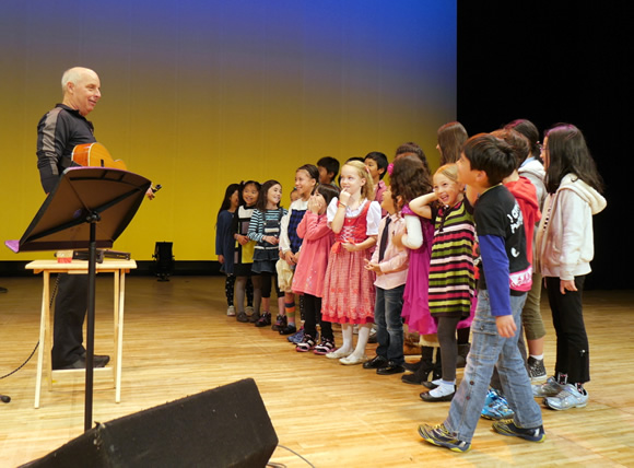 Bill rehearses with the children before the show.