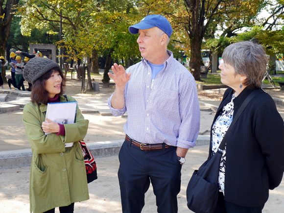 Michiko guides Bill and Debbie through Peace Memorial Park.