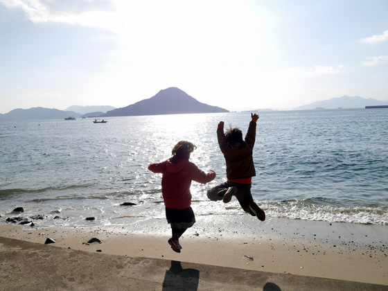 Jumping for joy at Hiroshima Bay