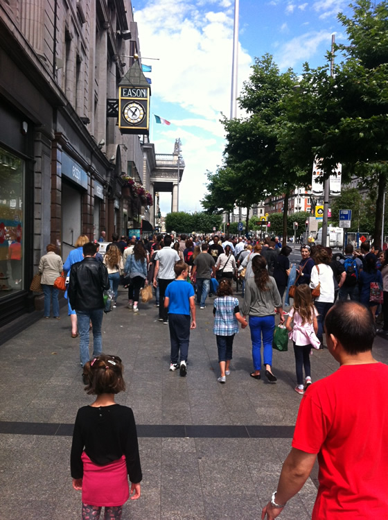 Strolling down lively O'Connell Street