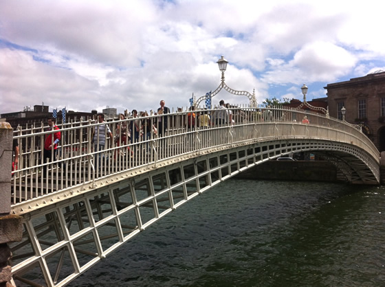 Crossing the Ha'Penny Bridge, which spans the River Liffey