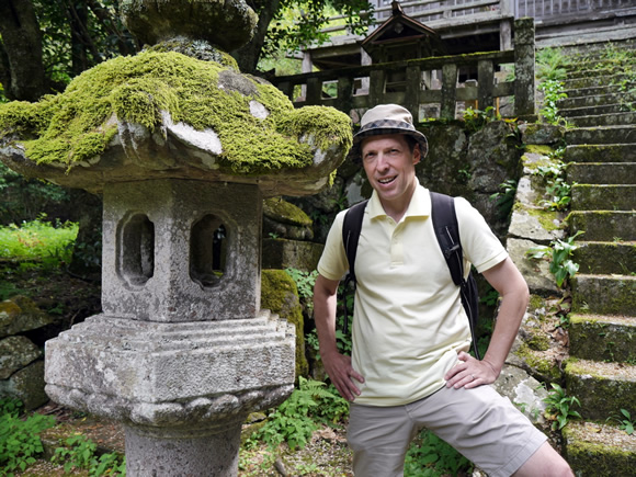 Mossy stone lantern, with poisonous spiders crawling on it (really!)