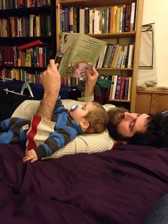 Sam reads aloud to his son