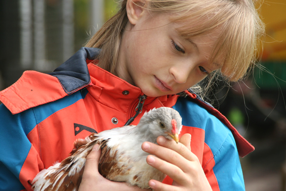 Zita holding one of her chickens.