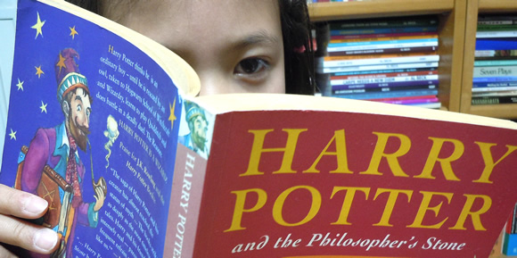 Lulu reading Harry Potter.