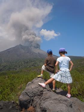 Sakurajima billows with smoke and ash.