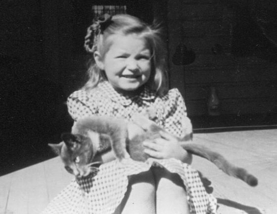 My mother, Katrine Aho, was a bilingual child and would grow to become a piano teacher, church organist, and lifelong cat-lover. (The cute cat pictured here was named Tippy.)
