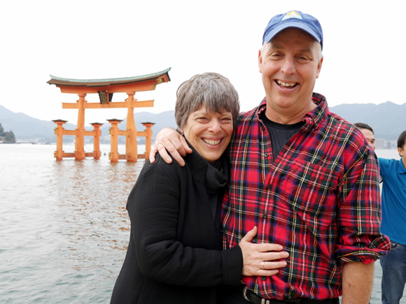 """Bill and Debbie in front of the """"floating gate"""" of Miyajima."""