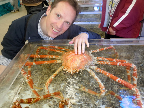 Adam pets a Japanese crab.