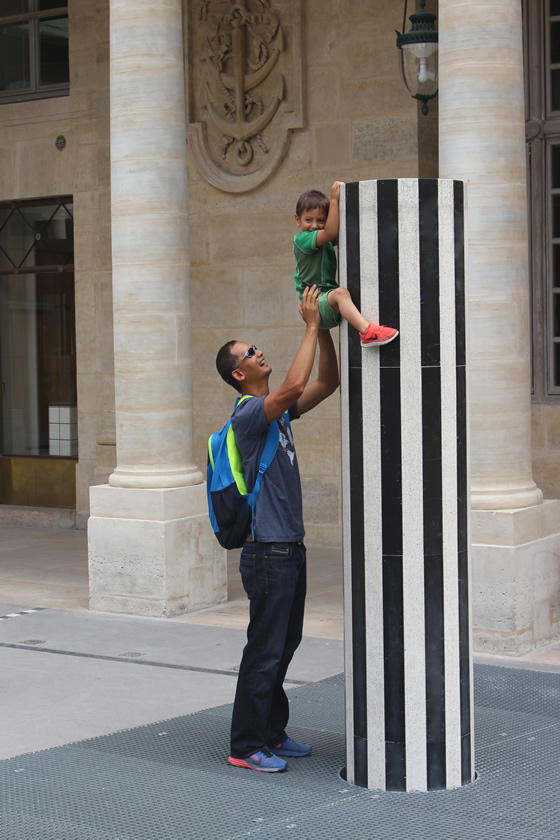 My husband and son playing with the columns at the Palais-Royal, Paris