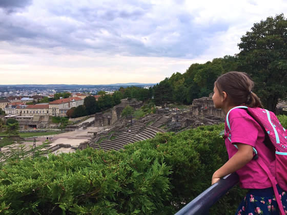 My daughter taking in a view of Lyon from the Roman amphitheater