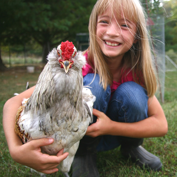 Author Zita Robertson with one of her chickens