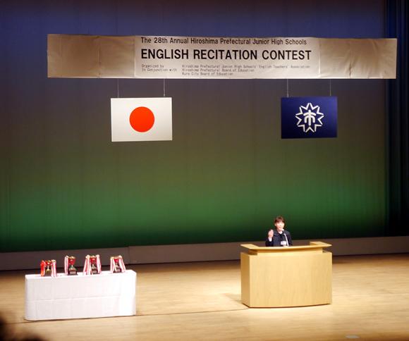 Lulu giving her speech in the finals of the speech contest.